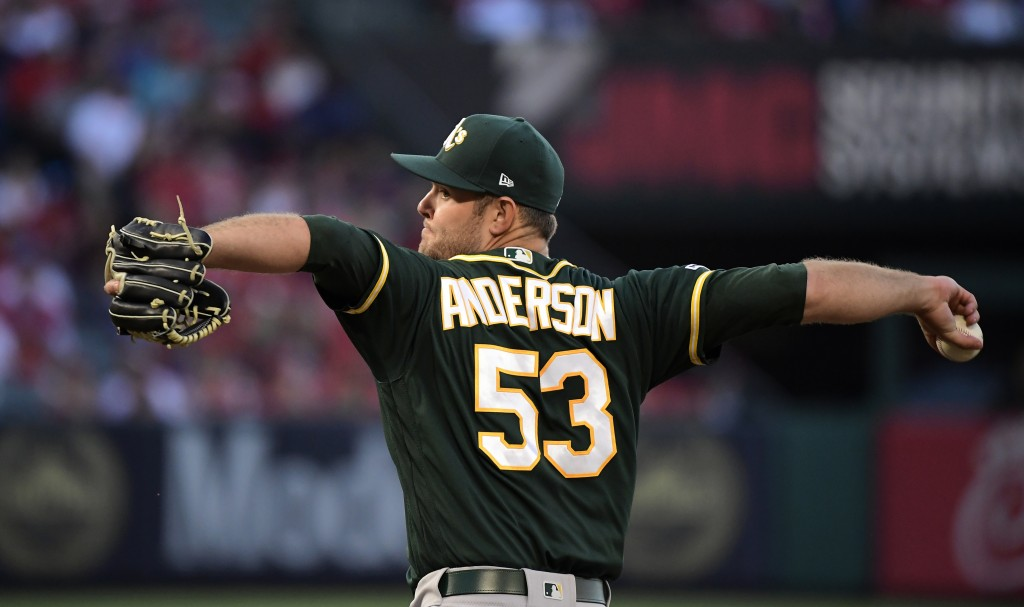 Oakland Athletics relief pitcher Tanner Anderson throws to the plate during the first inning of the team's baseball game against the Los Angeles Angel...