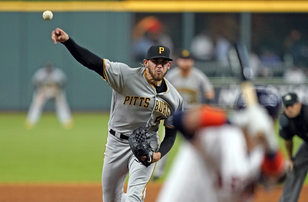 Pittsburgh Pirates starting pitcher Joe Musgrove throws to Houston Astros' Yuli Gurriel, right, during the sixth inning of a baseball game Thursday, J...