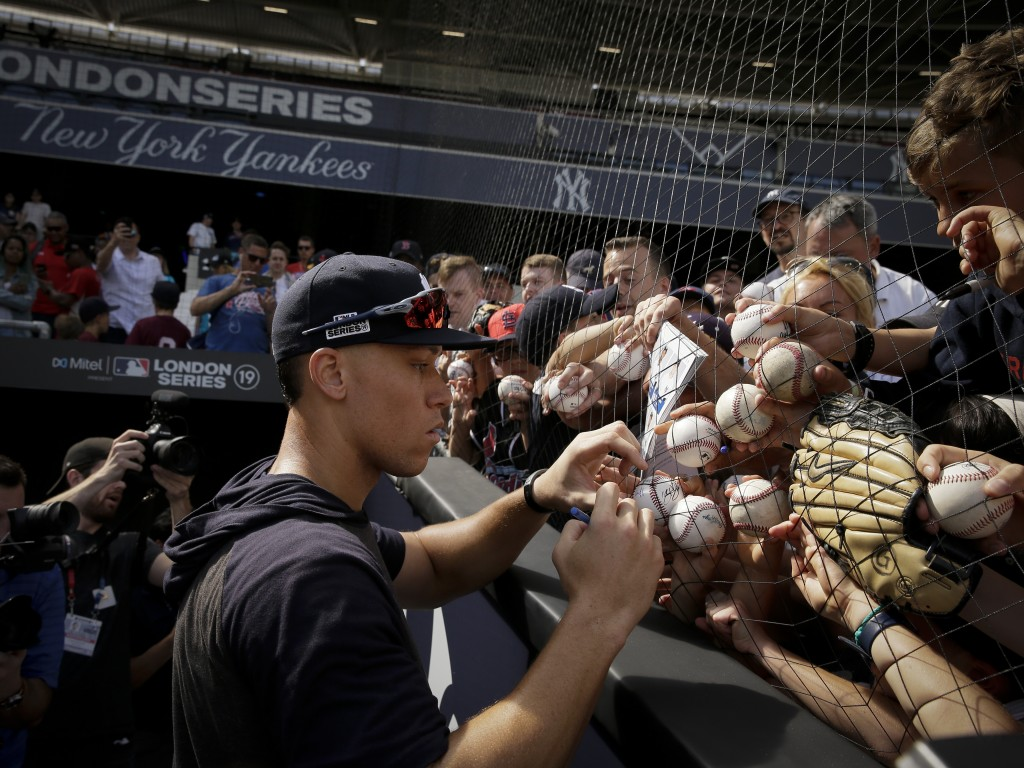 New York Yankees right fielder Aaron Judge signs autographs after batting practice in London, Friday, June 28, 2019. Major League Baseball will make i...