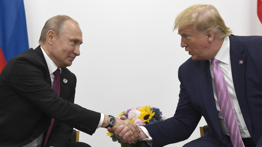 President Donald Trump, right, shakes hands with Russian President Vladimir Putin  during a bilateral meeting on the sidelines of the G-20 summit in O...