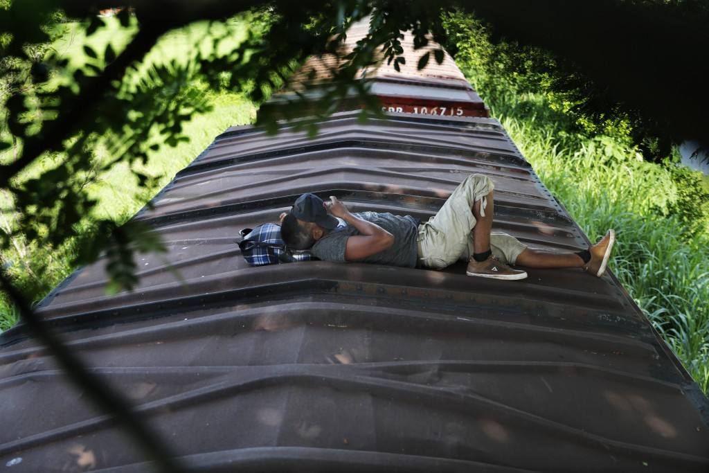 A Honduran migrant rides a freight train on his way north, in Salto del Agua, Mexico, Tuesday, June 25, 2019. Mexico has deployed 6,500 National Guard...