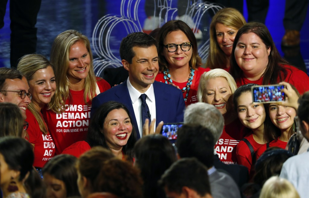 Democratic presidential candidate South Bend Mayor Pete Buttigieg poses with an advocacy group after the Democratic primary debate hosted by NBC News ...