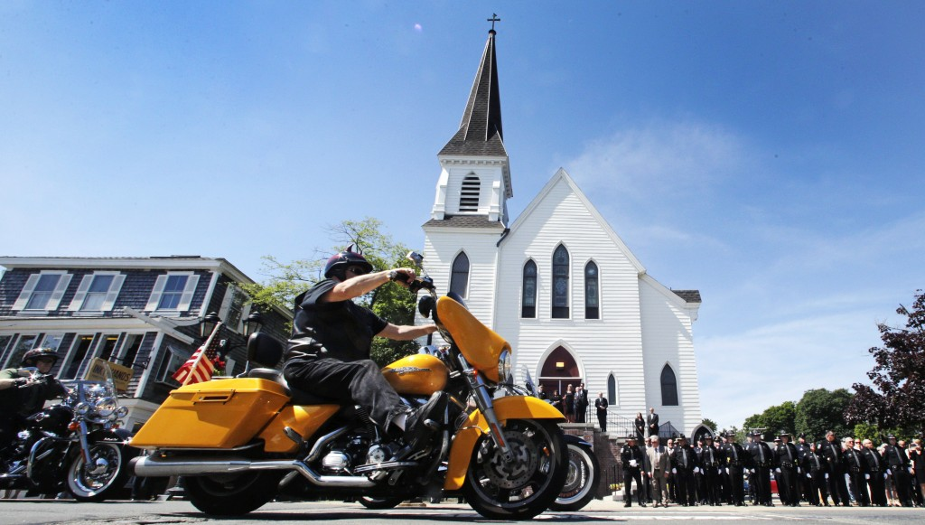 Members of the Jarheads Motorcycle Club pass police honor guards as they roll up to the funeral for Michael Ferazzi at St. Peter's Catholic Church in ...
