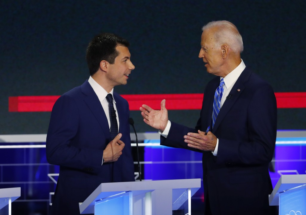 Democratic presidential candidate former vice president Joe Biden speaks to South Bend Mayor Pete Buttigieg during a break in the Democratic primary d...