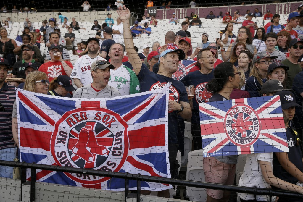 Fans cheers during the Boston Red Sox batting practice in London, Friday, June 28, 2019. Major League Baseball will make its European debut with the N...