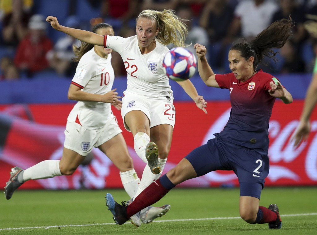 Norway's Ingrid Moe Wold, right, tries to block a shot of England's Beth Mead, left, during the Women's World Cup quarterfinal soccer match between No...