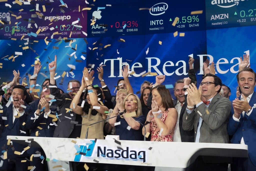 Julie Wainwright, center, CEO of The RealReal, celebrates her company's IPO at the Nasdaq opening bell, Friday, June 28, 2019 in New York. The online ...
