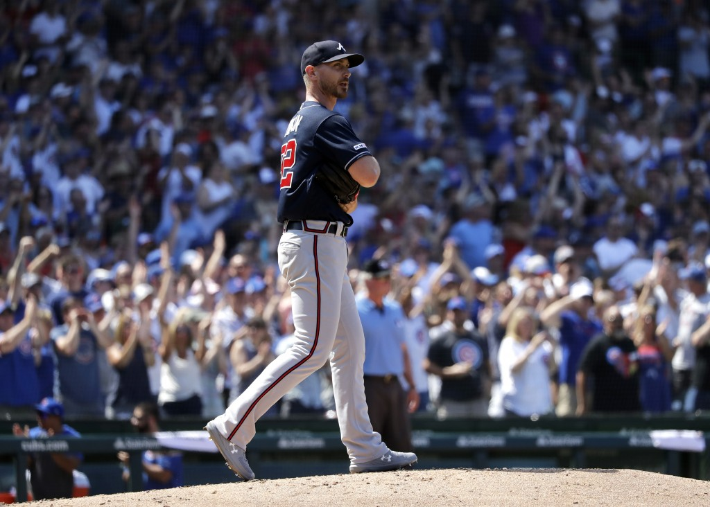 Atlanta Braves relief pitcher Josh Tomlin watches after Chicago Cubs' Victor Caratini hit a two-run home run during the fifth inning of a baseball gam...