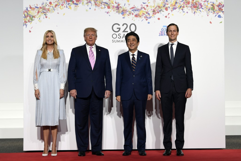 President Donald Trump poses for a photo with Japanese Prime Minister Shinzo Abe and Ivanka Trump and senior advisor Jared Kushner ahead of a meeting ...