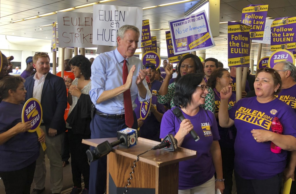 New York City Mayor and and presidential candidate Bill de Blasio joins a strikers at Miami International Airport Thursday, June 27, 2019. During his ...