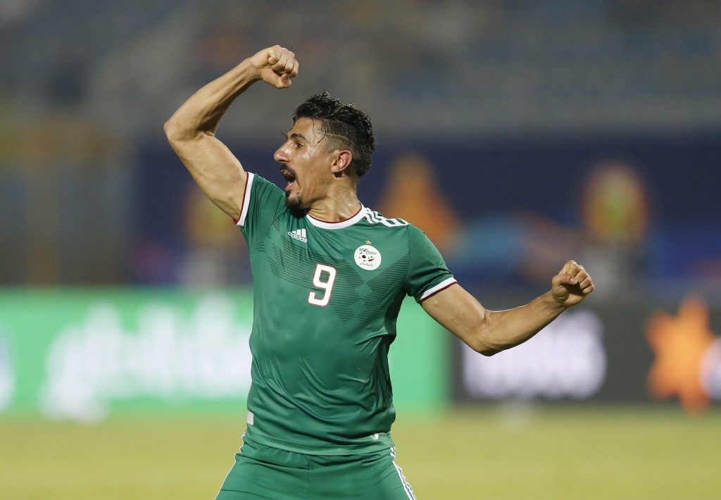 Algeria's Baghdad Bounedjah celebrates at the end of the African Cup of Nations group C soccer match between Algeria and Senegal at 30 June Stadium in...
