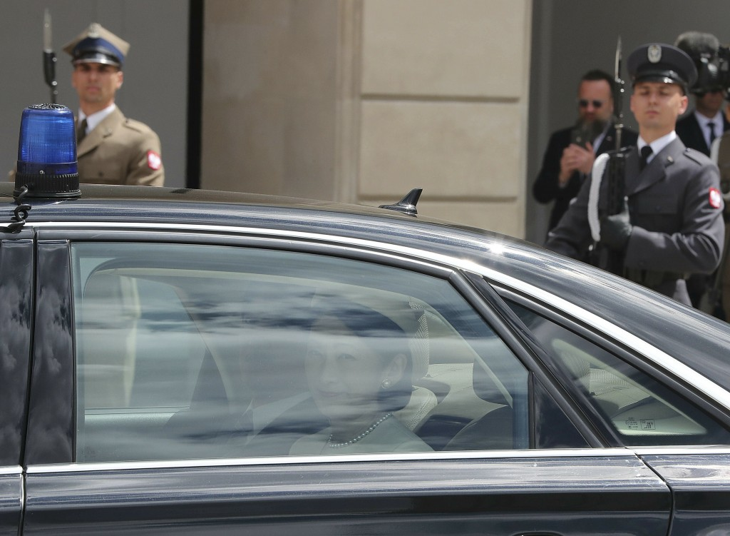 Japanese Crown Princess Kiko looks out the window of a car as she and Crown Prince Akishino arrive for a welcoming ceremony at the Polish Presidential...