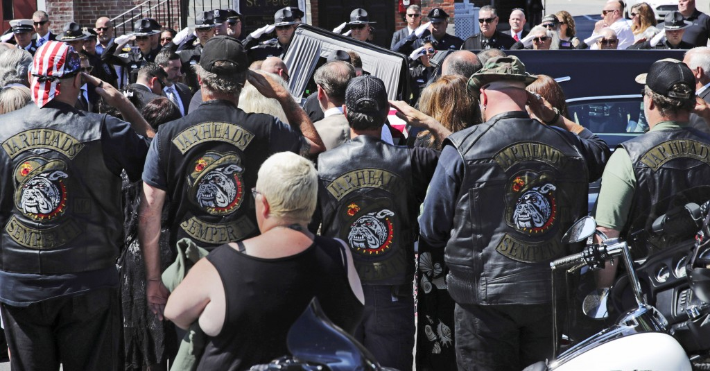 Members of the Jarheads Motorcycle Club and a police honor guard salute as the casket of Michael Ferazzi arrives at St. Peter's Catholic Church in Ply...
