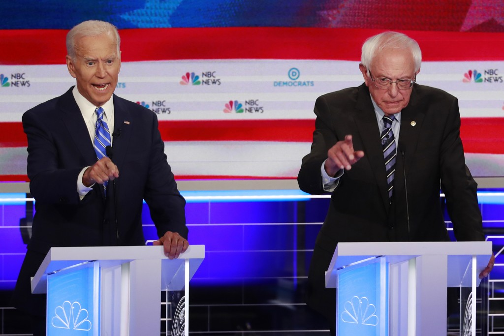 Democratic presidential candidate former vice president Joe Biden, left, and Sen. Bernie Sanders, I-Vt speak at the same time during the Democratic pr...