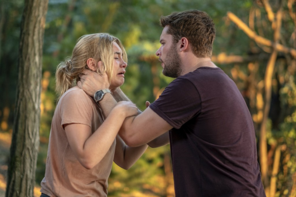 "This image released by A24 shows Jack Reynor and Florence Pugh, left, in a scene from the horror film ""Midsommar."" (Gabor Kotschy/A24 via AP)"