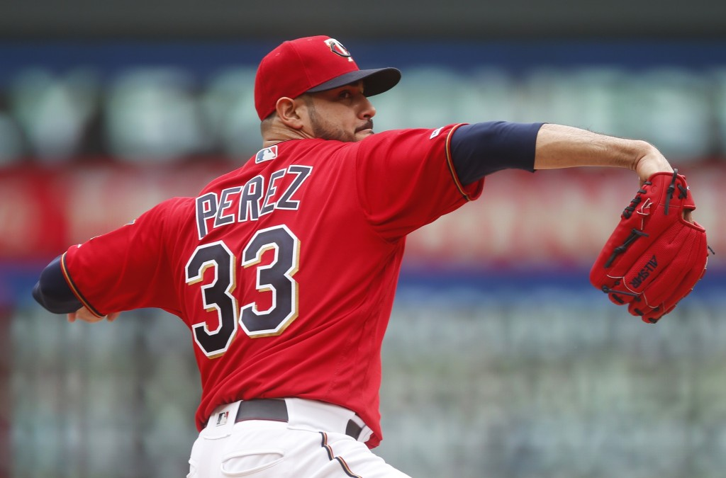 Minnesota Twins pitcher Martin Perez throws against the Tampa Bay Rays in the first inning of a baseball game Thursday, June 27, 2019, in Minneapolis....