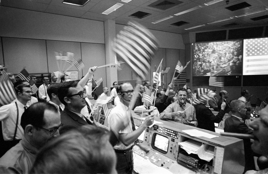 In this July 24, 1969 photo made available by NASA, flight controllers at the Mission Operations Control Room in the Mission Control Center at the Man...