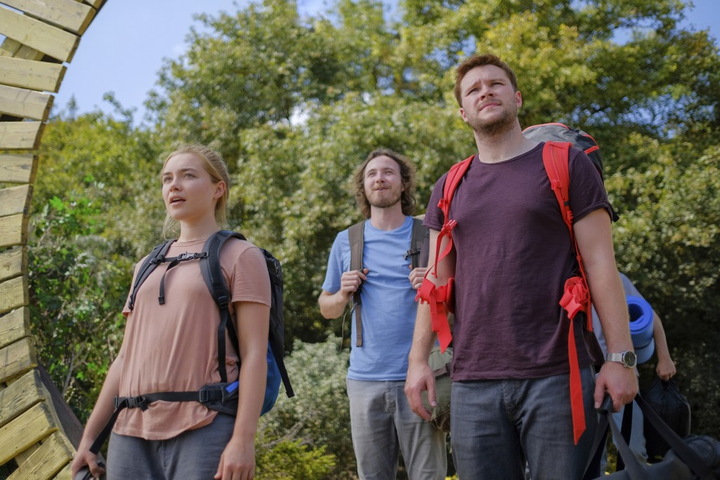 """This image released by A24 shows Jack Reynor, right, and Florence Pugh in a scene from the horror film """"Midsommar."""" (Gabor Kotschy/A24 via AP)"""