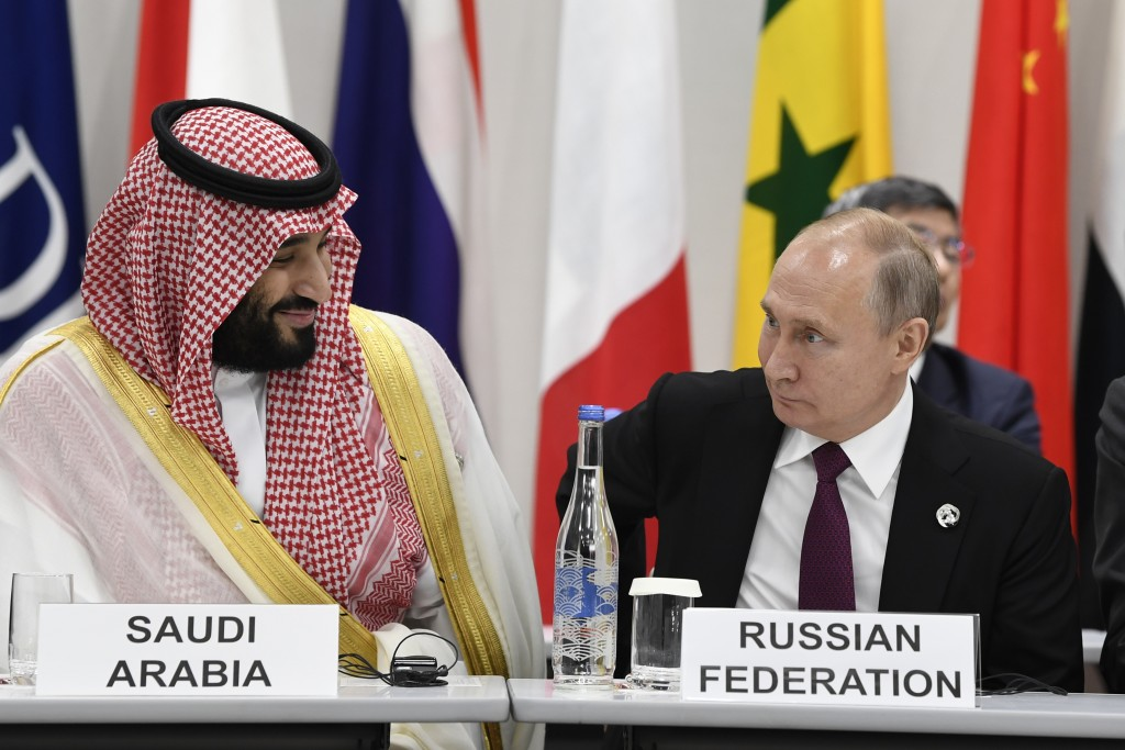 Saudi Arabia's Crown Prince Mohammed bin Salman and Russian President Vladimir Putin talk before a working session of leaders at the G-20 summit in Os...
