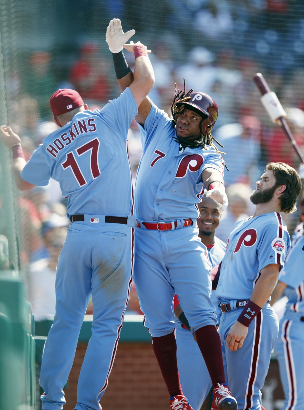 Philadelphia Phillies' Maikel Franco (7) and Rhys Hoskins (17) celebrate after Franco hit a two-run home run off New York Mets relief pitcher Edwin Di...
