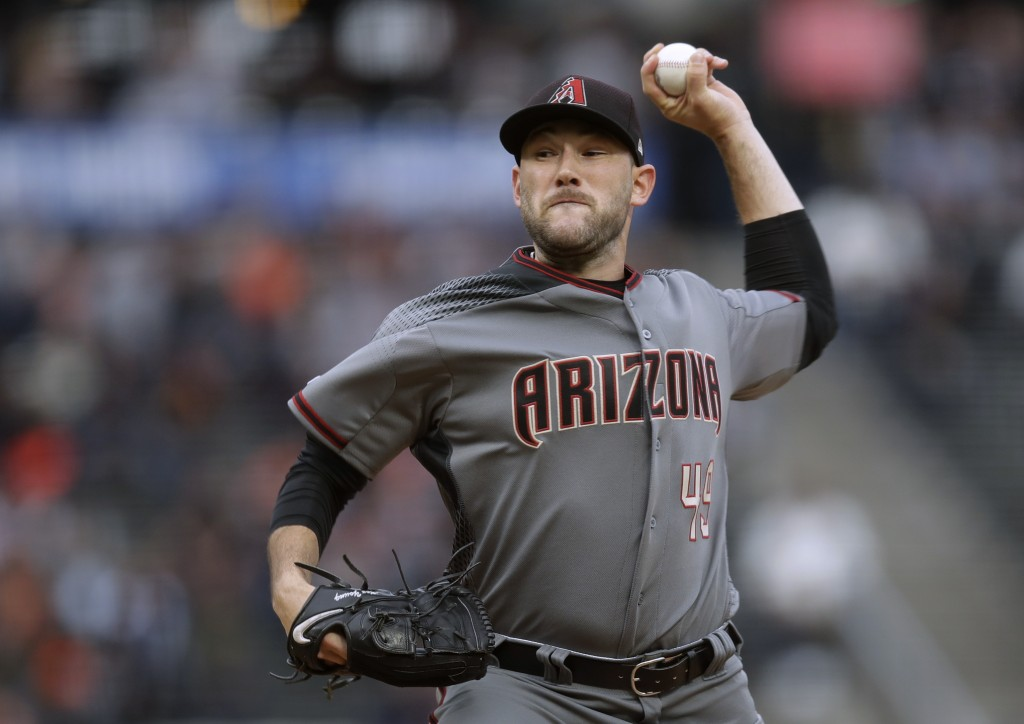 Arizona Diamondbacks pitcher Alex Young works against the San Francisco Giants during the first inning of a baseball game Thursday, June 27, 2019, in ...