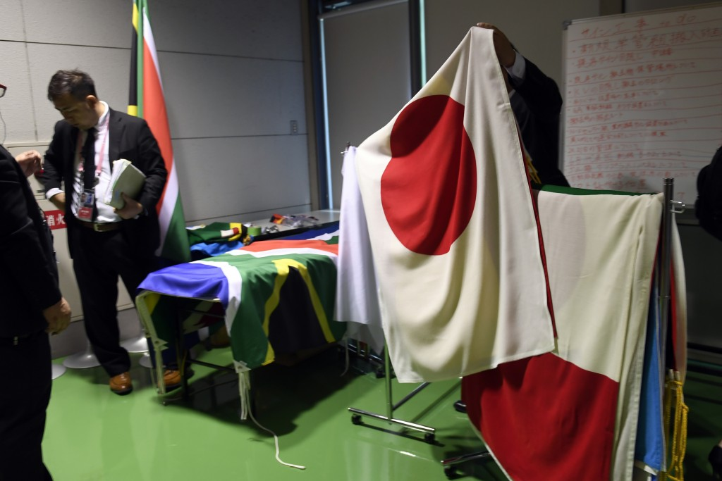 The flags to be used at the G-20 summit in Osaka, Japan, Friday, June 28, 2019, for the various meetings are prepared. (AP Photo/Susan Walsh)