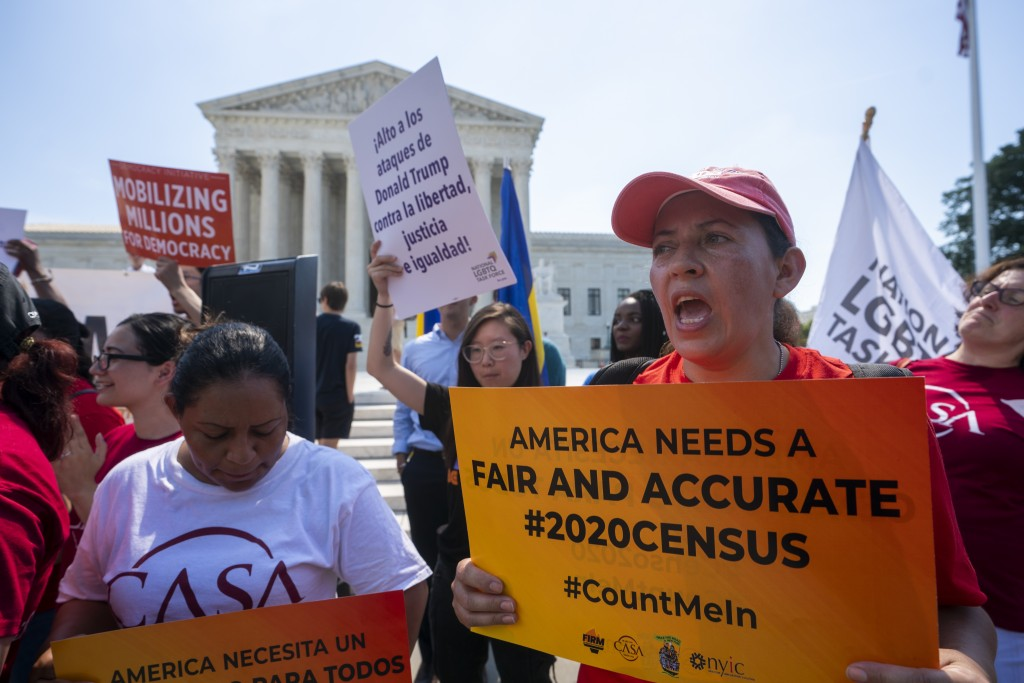 Demonstrators gather at the Supreme Court as the justices finish the term with key decisions on gerrymandering and a census case involving an attempt ...