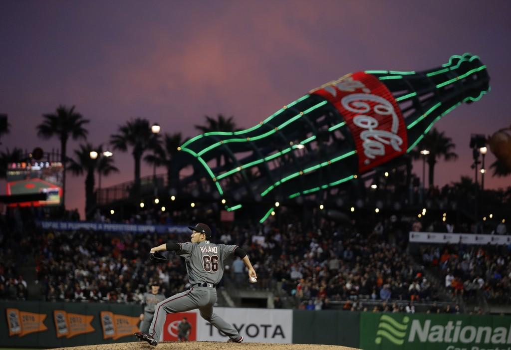 Arizona Diamondbacks pitcher Yoshihisa Hirano works against the San Francisco Giants during the sixth inning of a baseball game Thursday, June 27, 201...