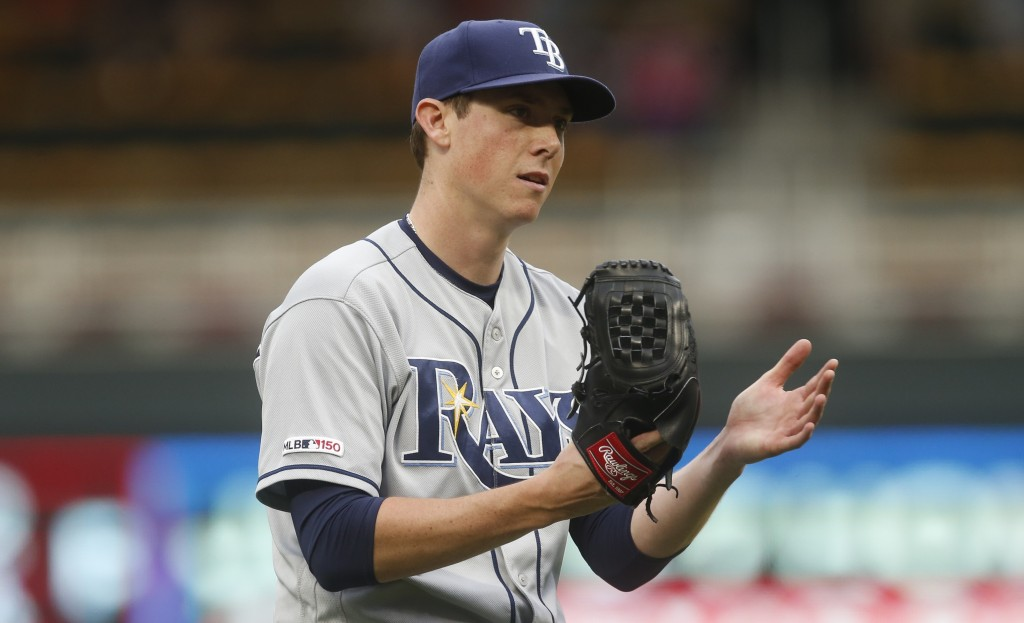 Tampa Bay Rays pitcher Ryan Yarbrough celebrates the final out of the 18th inning against the Minnesota Twins in Minneapolis. The Rays won 5-2. (AP Ph...