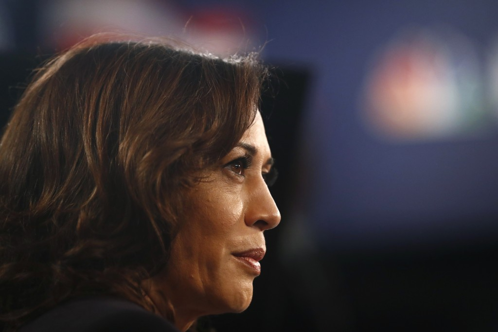 Democratic presidential candidate Sen. Kamala Harris, D-Calif., listens to questions in the spin room after the Democratic primary debate hosted by NB