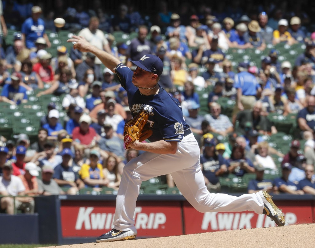 Milwaukee Brewers starting pitcher Chase Anderson throws during the first inning of a baseball game against the Seattle Mariners Thursday, June 27, 20...