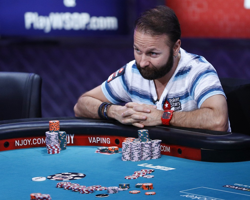 FILE - In this July 14, 2015, file photo, Daniel Negreanu looks at Joseph McKeehen as they play at the World Series of Poker main event in Las Vegas. ...