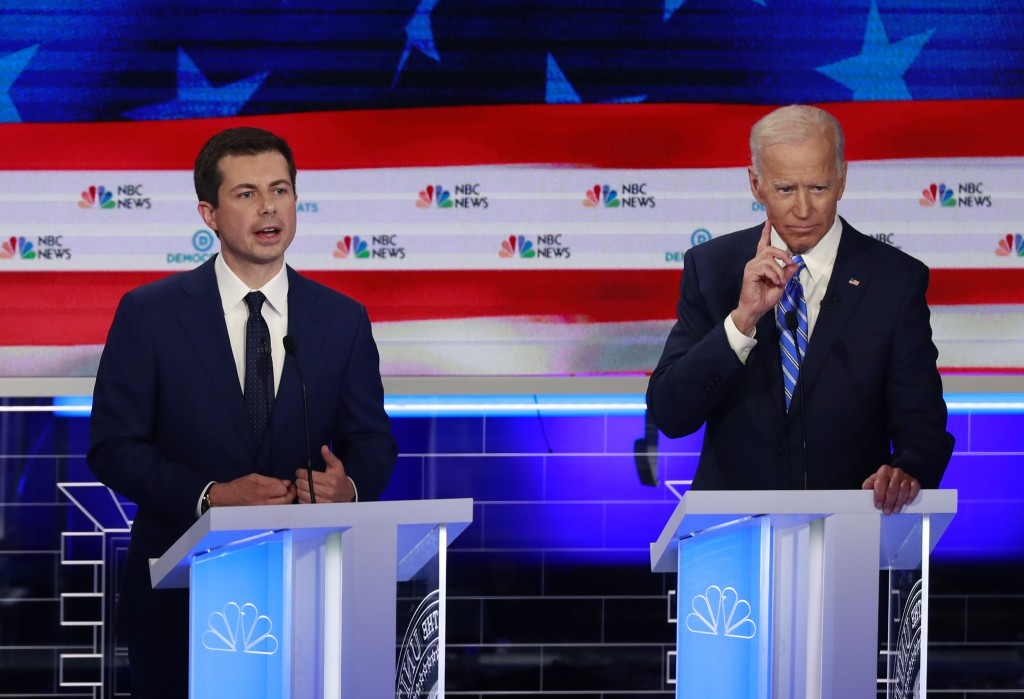 Democratic presidential candidate South Bend Mayor Pete Buttigieg, left, speaks as former vice president Joe Biden gestures, during the Democratic pri...