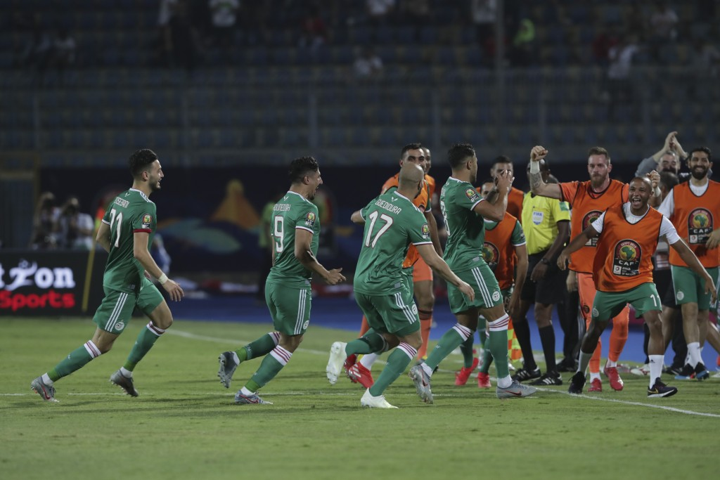 Algerian players celebrate after a goal during the African Cup of Nations group C soccer match between Algeria and Senegal at 30 June Stadium in Cairo...