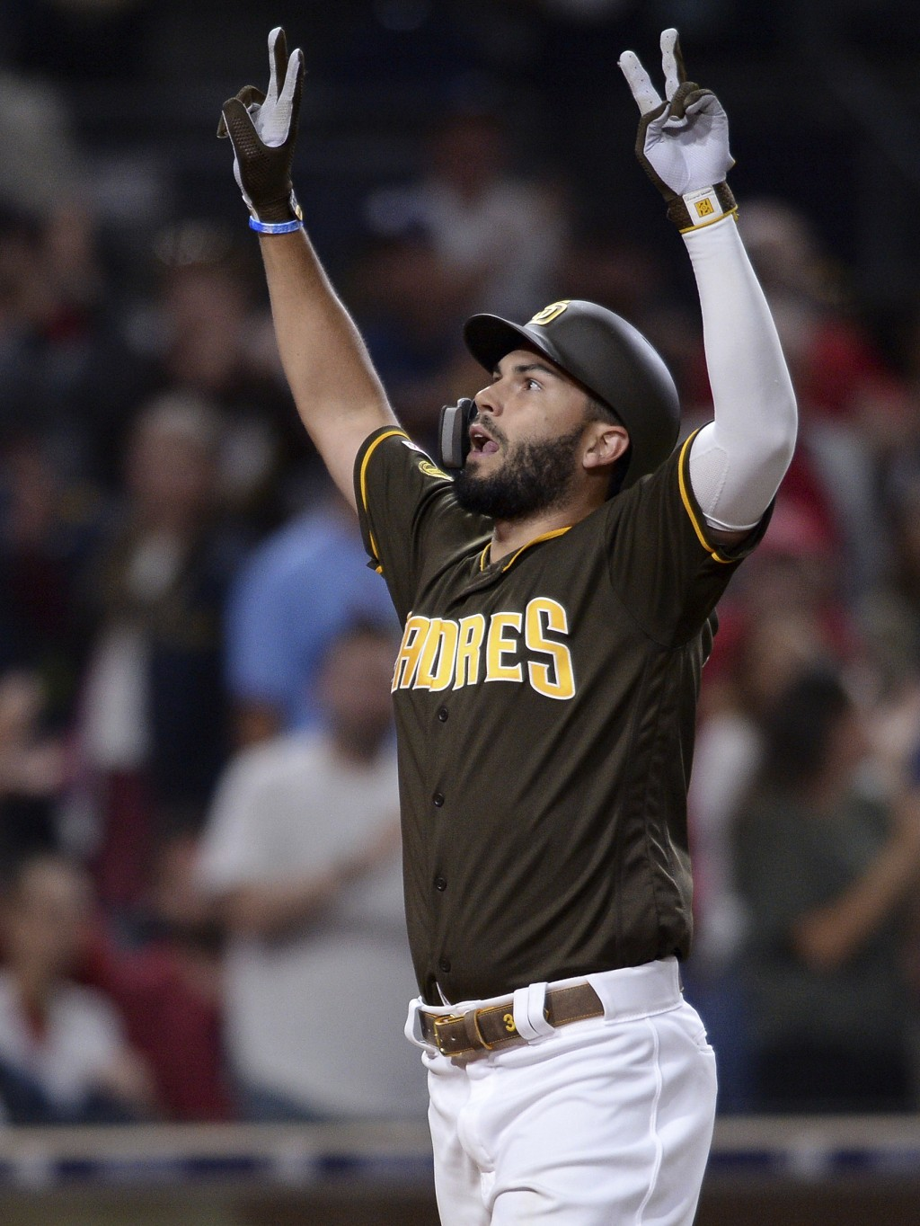 San Diego Padres' Eric Hosmer reacts after hitting a home run during the sixth inning of the team's baseball game against the St. Louis Cardinals on F...