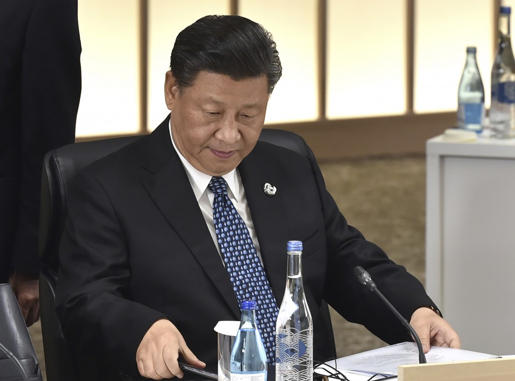 Chinese President Xi Jinping attends the session 3 on women's workforce participation, future of work, and aging societies at the G-20 summit in Osaka...
