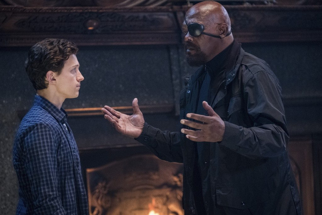 """This image released by Sony Pictures shows Tom Holland, left, and Samuel L. Jackson in a scene from """"Spider-Man: Far From Home."""" (Jay Maidment/Columbi..."""