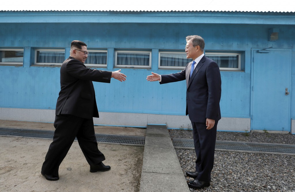 FILE - In this April 27, 2018, file photo, North Korean leader Kim Jong Un, left, prepares to shake hands with South Korean President Moon Jae-in over...
