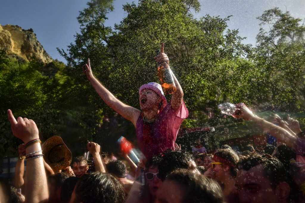 Reveler takes part in a wine battle, in the small village of Haro, northern Spain, Saturday, June 29, 2019. Hundreds of revelers participate in this f...