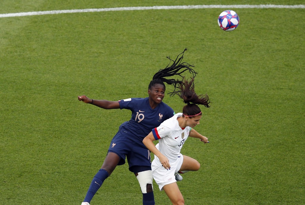 France's Griedge Mbock Bathy, left, jumps for the ball with United States' Alex Morgan during the Women's World Cup quarterfinal soccer match between ...