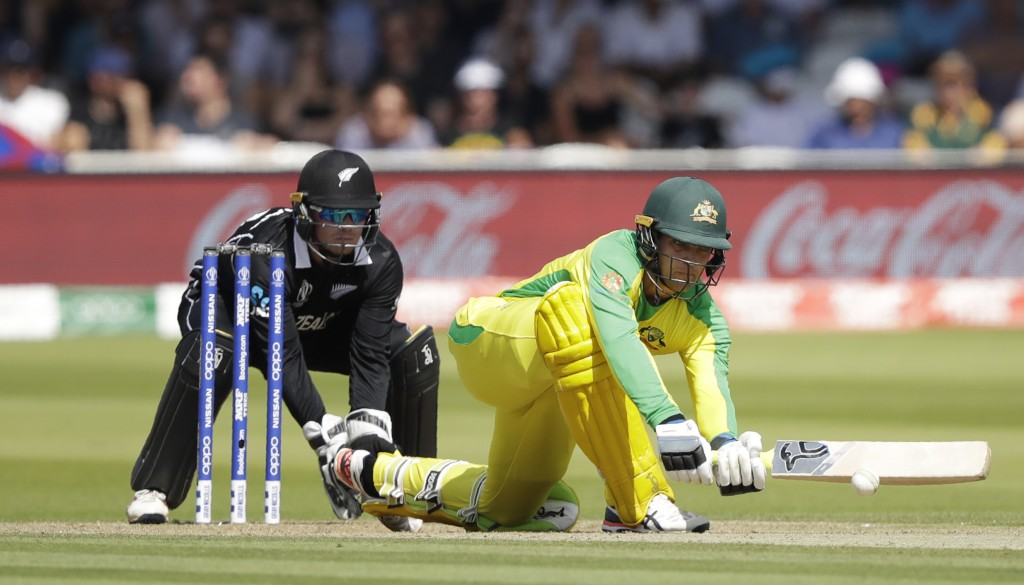 Australia's Alex Carey plays a shot off the bowling of New Zealand's Mitchell Santner during the Cricket World Cup match between New Zealand and Austr...