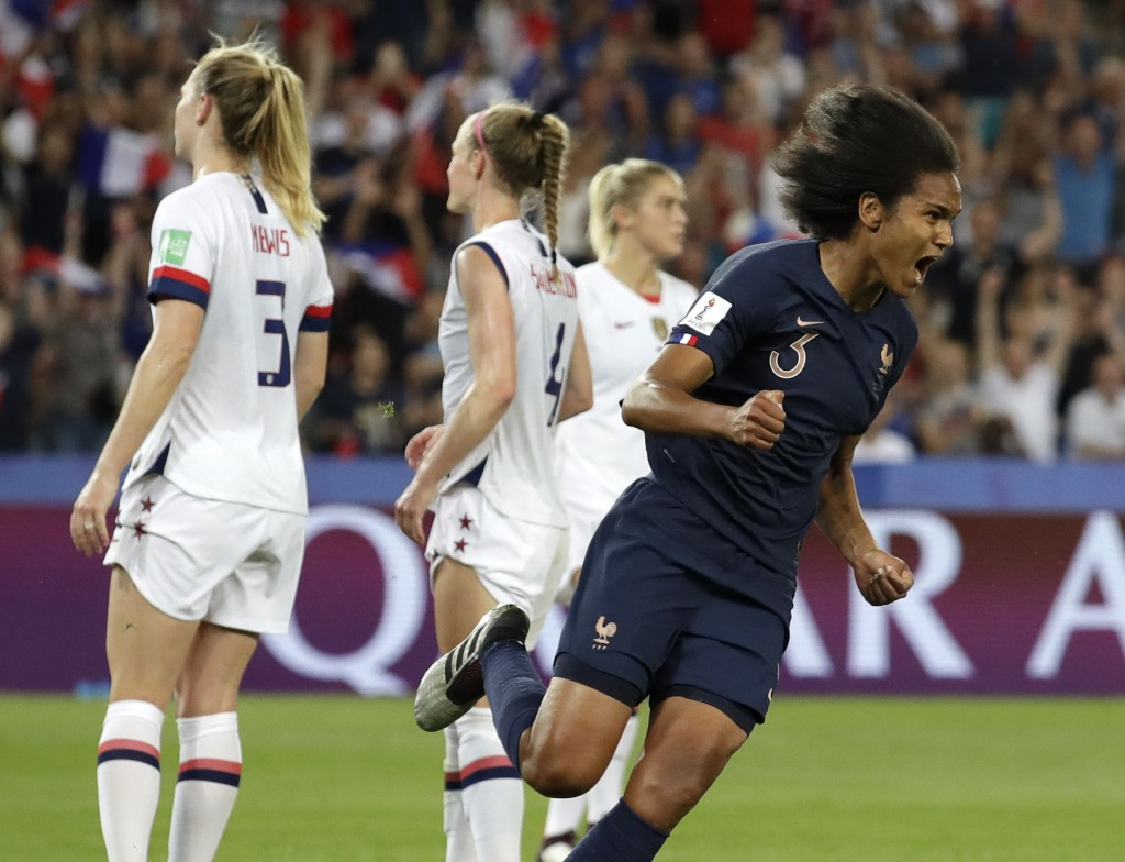 France's Wendie Renard, right, celebrates after scoring her team's first goal during the Women's World Cup quarterfinal soccer match between France an...
