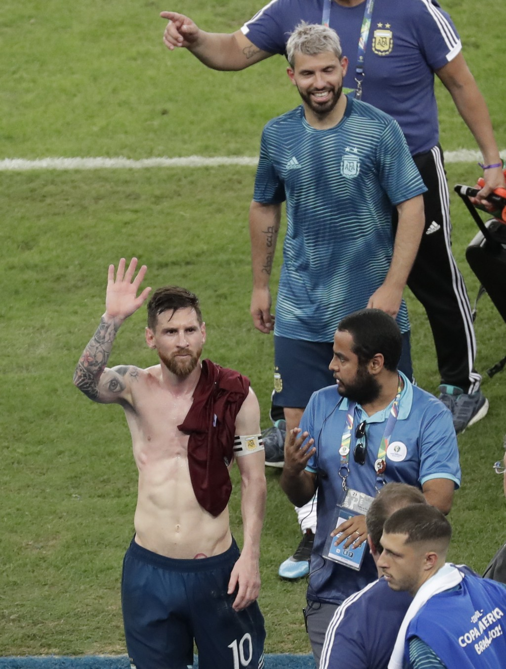 Argentina's Lionel Messi, bottom, waves to fans as teammate Sergio Aguero, top, smiles at the end of a Copa America quarterfinal soccer match against ...