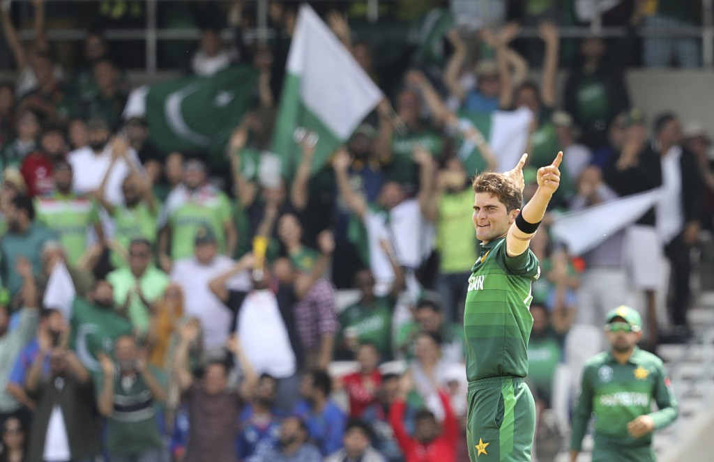 Pakistan's Shaheen Afridi celebrates after the dismissal of Afghanistan's Rashid Khan during the Cricket World Cup match between Pakistan and Afghanis...