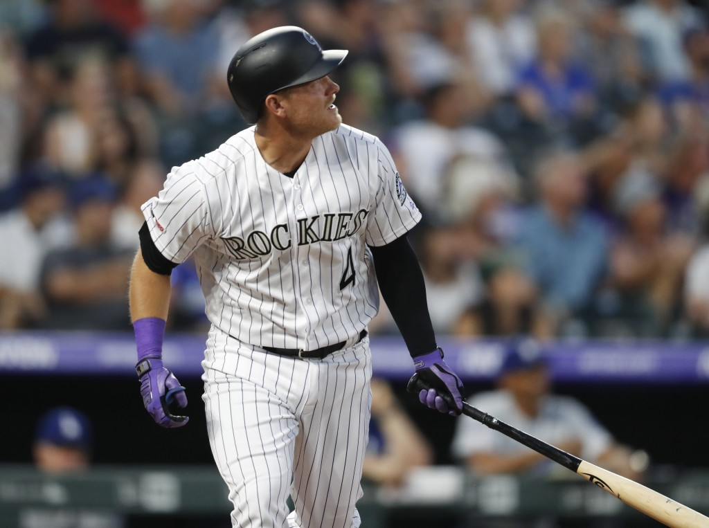 Colorado Rockies pinch-hitter Pat Valaika follows the flight of his two-run home run off Los Angeles Dodgers starting pitcher Hyun-Jin Ryu in the fift...