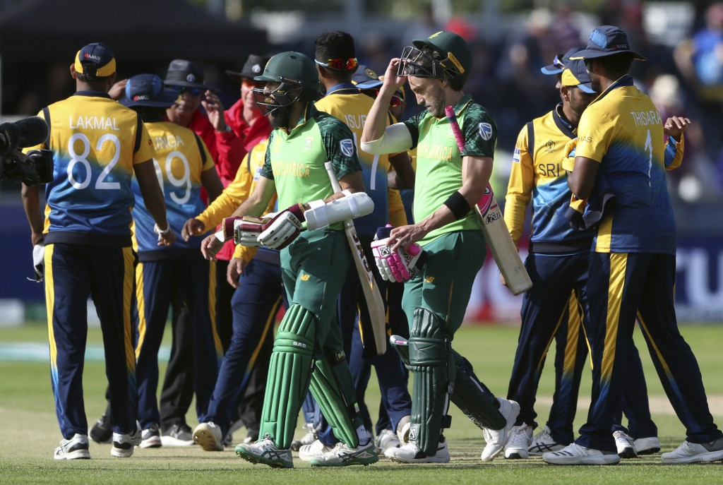 South Africa's batsman Hashim Amla, left, with his captain Faf du Plessis leave the field at the end of the Cricket World Cup match between Sri Lanka ...