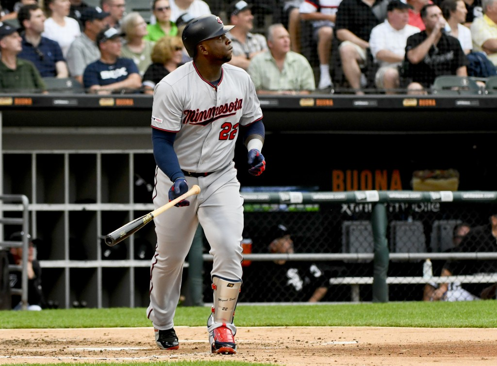 Minnesota Twins' Miguel Sano watches his two-run home run during the second inning of the team's baseball game against the Chicago White Sox on Friday...