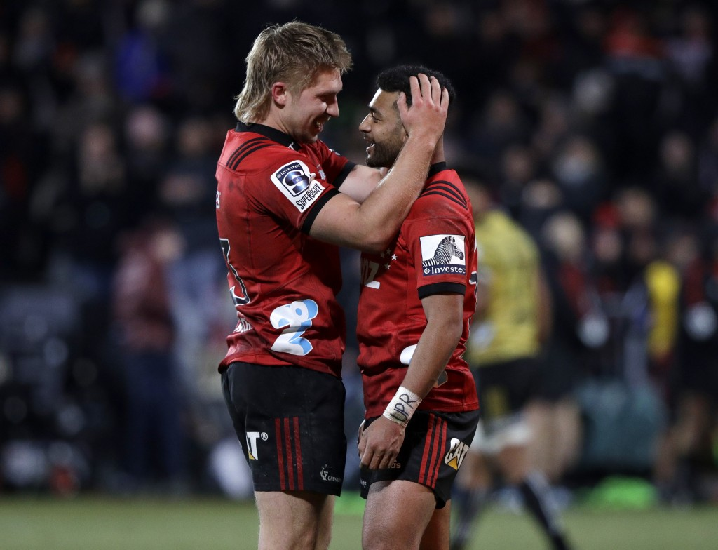 Crusaders Jack Goodhue and Richie Mo'unga, right, celebrate after defeating the Hurricanes in their Super Rugby semifinal in Christchurch, New Zealand...