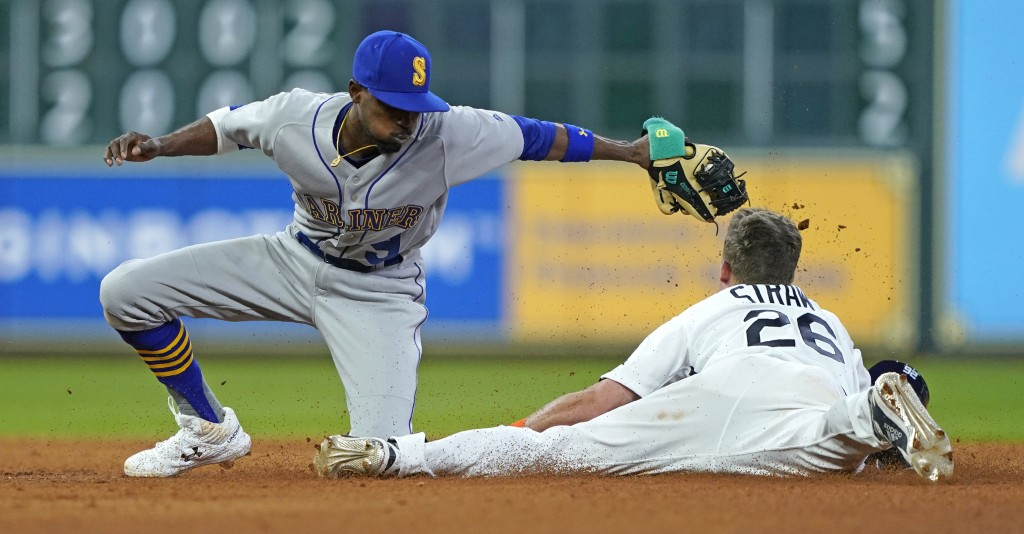 Houston Astros' Myles Straw (26) steals second base as Seattle Mariners' Dee Gordon (9) reaches to tag him during the seventh inning of a baseball gam...