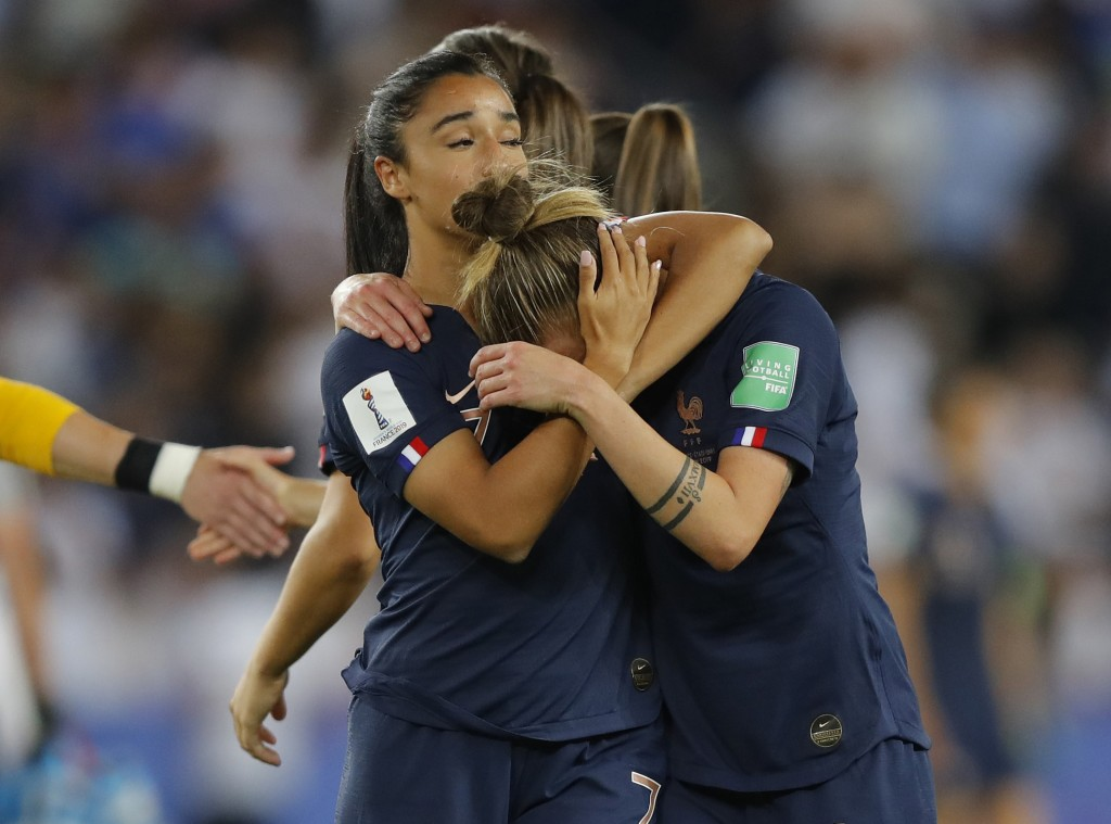 France's Marion Torrent, right, and Sakina Karchaoui react after the Women's World Cup quarterfinal soccer match between France and the United States ...